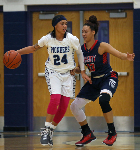 Canyon Springs' Daijhan Cooks, left, is guarded by Liberty's Aubre Fortner durin ...