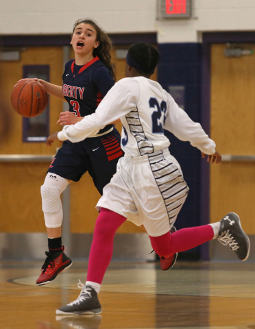 Liberty's CeCe Quintino, left, drives against Canyon Springs' Khelsea Smith duri ...