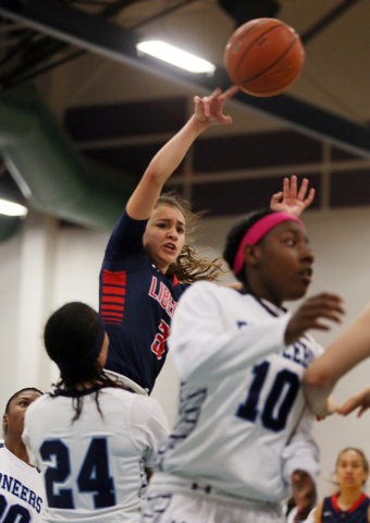 Liberty's CeCe Quintino, back, goes up for a shot during Wednesday's game at Can ...