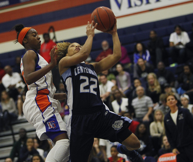 Centennial's Teirra Hicks (22) drives to the hoop against Bishop Gorman's Maddis ...