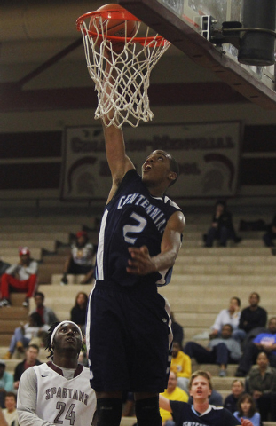 Centennial's Troy Brown (2) goes in for a dunk past Cimarron-Memorial's Cameron ...