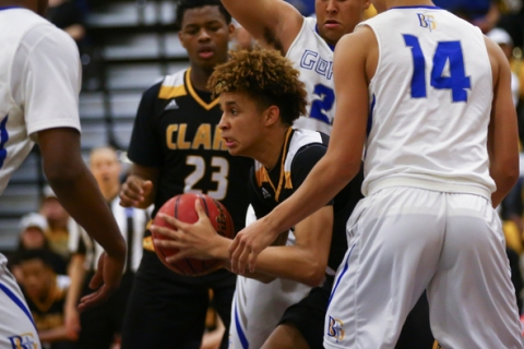 Clark forward Jalen Hill (20) looks for an open pass during a basketball game at Bishop Gorm ...