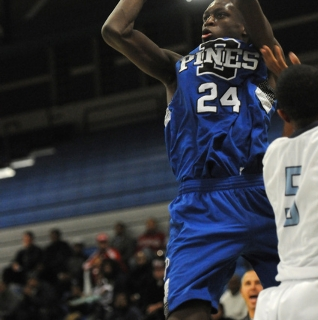 Desert Pines' Nate Grimes (24) takes a shot over Canyon Springs' Gerad Davis on ...