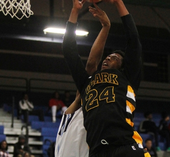 Clark's Diontae Jones (24) grabs a rebound over Canyon Springs' Maurice Hunter ( ...