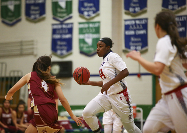 Liberty's Dre'una Edwards (44) drives to the basket against Downey during the Ga ...