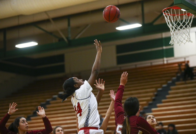 Liberty's Dre'una Edwards (44) goes up to score against Downey during the Gator ...