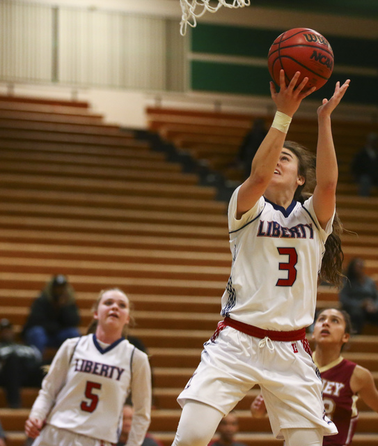 Liberty's Celine Quintino (3) goes up for a shot against Downey during the Gator Winte ...