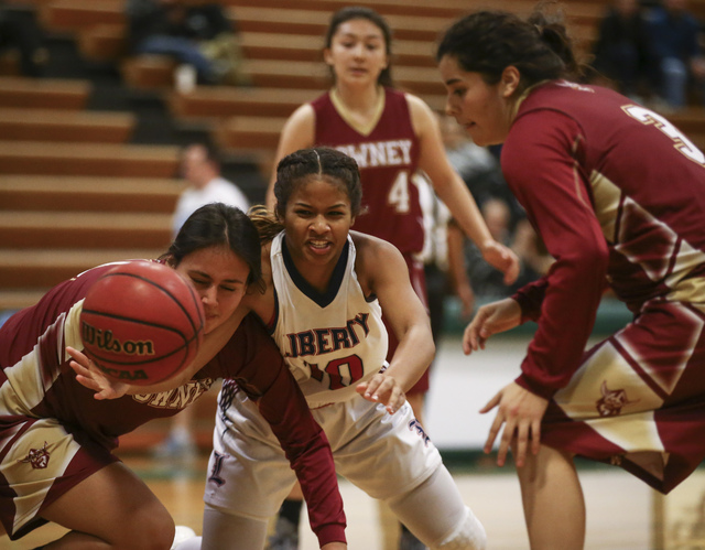 Liberty's Janae Nickels (10) loses control of the ball while colliding with a Downey p ...