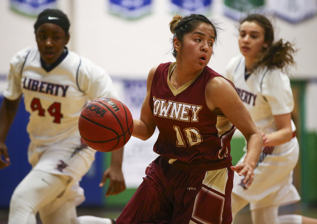 Downey's Surie Camacho (10) drives against Liberty during the Gator Winter Classic cha ...