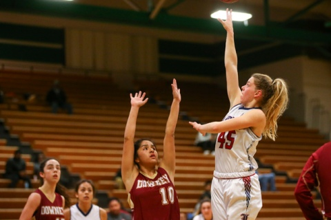 Liberty's Amanda Pemberton (45) goes up for a shot against Downey during the Gator Win ...