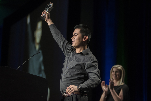 Desert Oasis student Ron Chan shows emotion after winning the No Limit award during the inau ...
