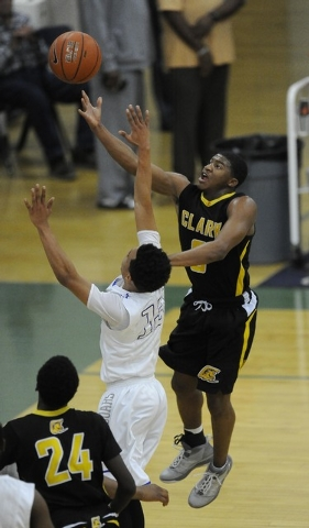 Clark guard Colby Jackson goes up for a layup against Desert Pines guard Coby Myles (13) in ...