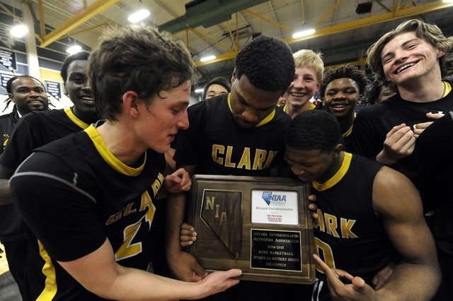 Clark Chargers players celebrate their 56-51 victory over Desert Pines in the Division I-A S ...