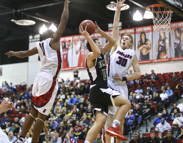 Clark guard James Bridges (15) drives to the basket against Coronado's Will Weems (11) ...