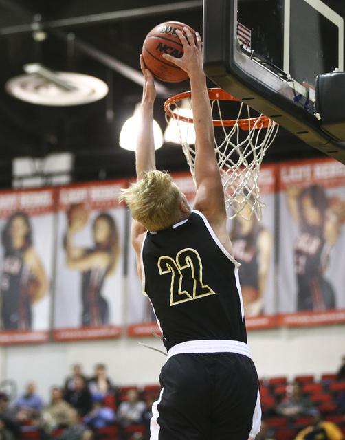 Clark guard Trey Woodbury (22) dunks against Coronado during the Class 4A boys state basketb ...