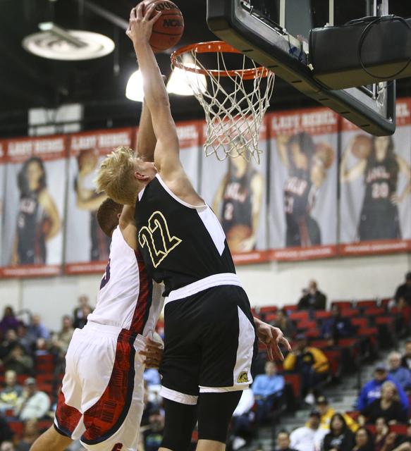 Clark guard Trey Woodbury (22) shoots against Coronado during the Class 4A boys state basket ...