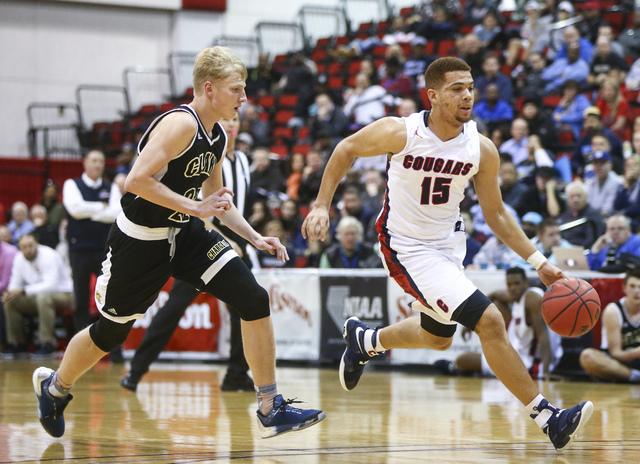 Coronado's Bryce Savoy (15) drives to the basket past Clark guard Trey Woodbury (22) d ...