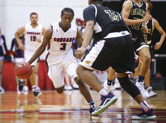 Coronado's Nick Davis (3) drives against Clark during the Class 4A boys state basketba ...