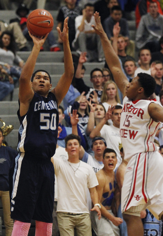 Centennial's Eddie Davis (50) hits a 3-pointer in front of Arbor View's Charles ...
