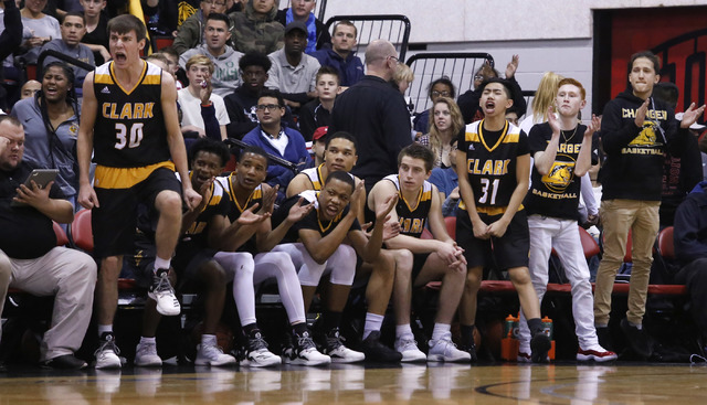 Clark players react during the first half of a Class 4A boys state final game at the Cox Pav ...