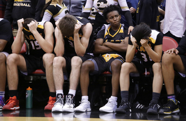 Clark players react after losing to Bishop Gorman in a Class 4A boys state championship fina ...