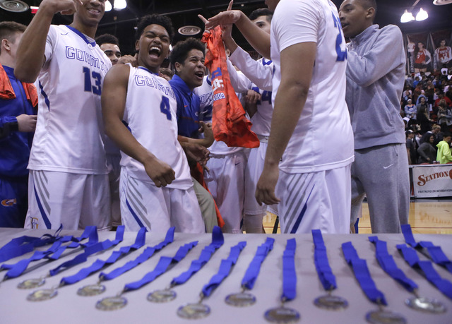 Bishop Gorman's players react after winning a Class 4A boys state final championship g ...