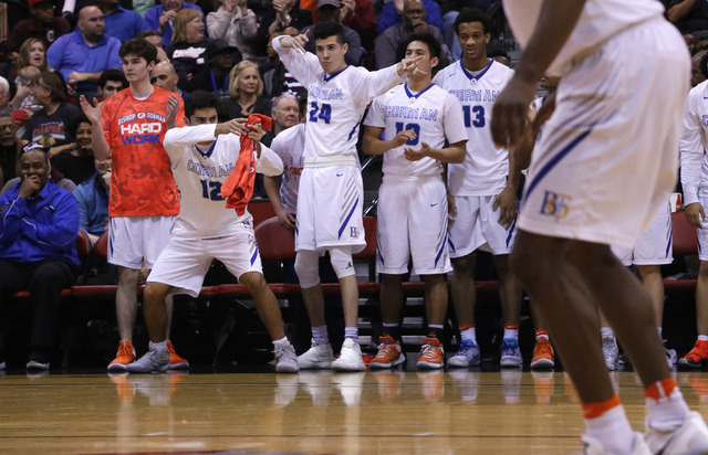 Bishop Gorman players react after one their teammates scores against Clark during the second ...