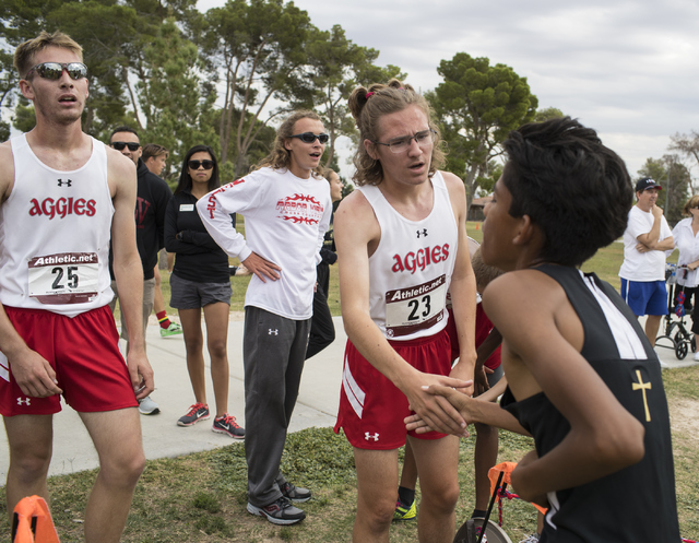 Second place winner Ian Jackson, center congratulates another player while Tim Myers, left, ...