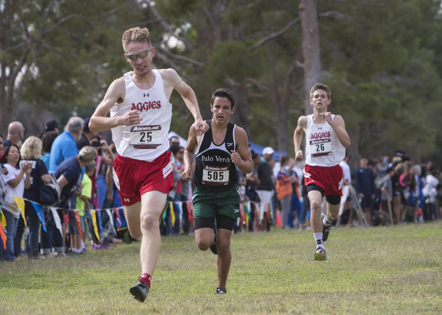 Tim Myers, from left, Evelio Vergara and Andrew Parker race to the finish line during the Re ...