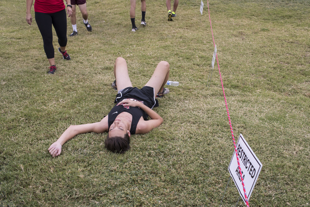 Jason Johnson rests after completing the Sunrise Boys 2016 NIAA Southern Regional cross coun ...