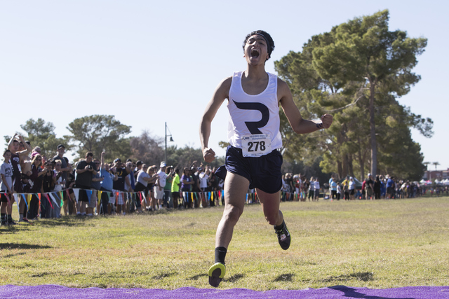 Anthony Ocegueda finishes first during the boys 4A NIAA State Championship meet at Craig Ran ...