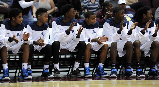 The Agassi Prep bench claps after a foul is called against The Meadows School in the first q ...