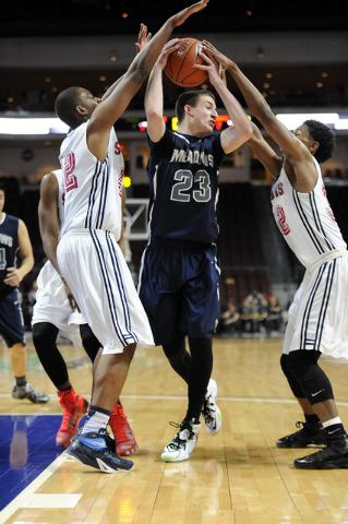 The Meadows School guard Jake Epstein (23) is surrounded byAgassi Prep forward Darius Coaxm, ...