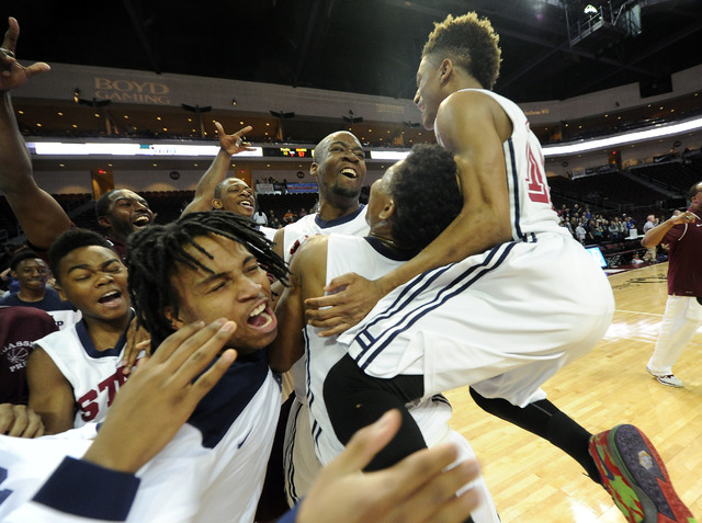 Agassi Prep players celebrate their win over The Meadows School in the Division III boys sta ...