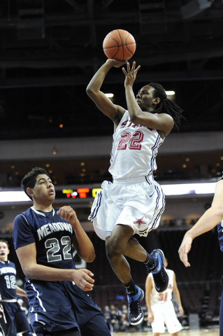 Agassi Prep forward Jordan Smith (22) is fouled by The Meadows School center Max Hisatake in ...