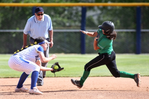 Rancho's Lili Gutierrez gets tagged out by Reed's Kenzi Goins during NIAA DI sof ...