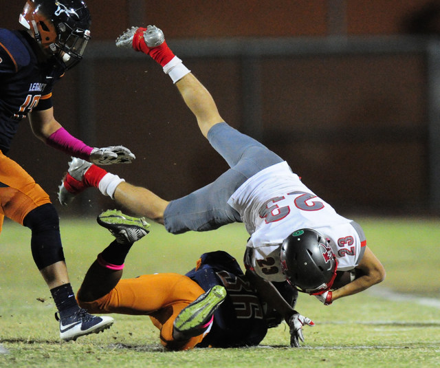 Arbor View running back Deago Stubbs (23) is upended after being tackled by Legacy safety Am ...