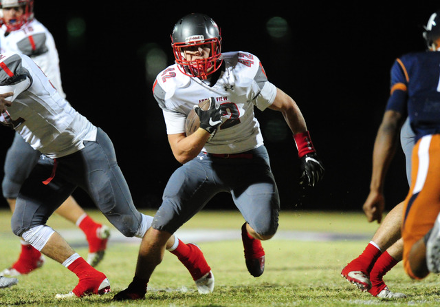 Arbor View fullback Andrew Wagner runs through a hole against Legacy in the first half of th ...
