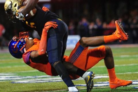 Bishop Gorman safety Greg Francis, bottom, tackles St. Thomas Aguinas, Fla. wide receiver Jo ...