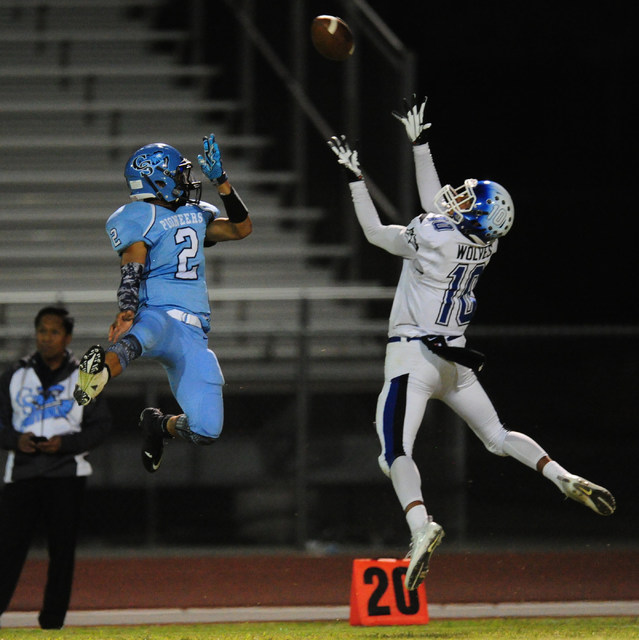 Basic High School wide receiver Xavier Caduto (10) is unable to catch a pass as Canyon Sprin ...