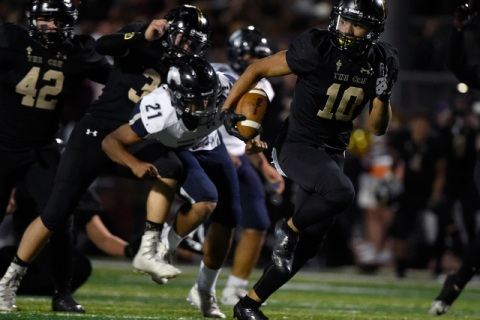Faith Lutheran's Taimani McKenzie (10) runs for a touchdown after recovering a fumble ...