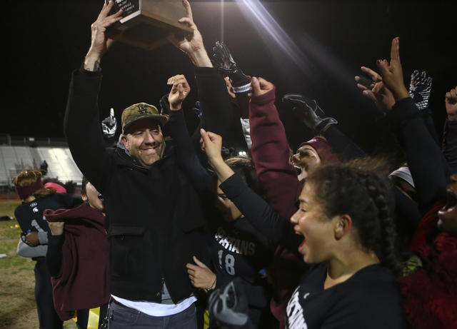 Cimarron-Memorial head coach Mark Bailey celebrates with his players after defeating Coronad ...