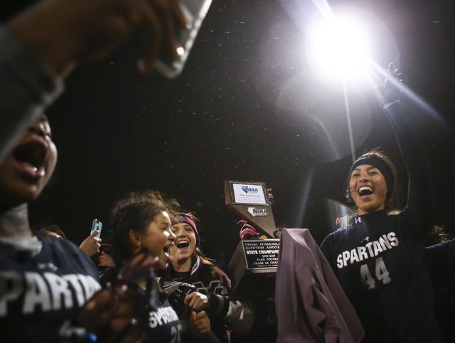 Cimarron-Memorial players celebrate after defeating Coronado 24-7 in the Class 4A state cham ...