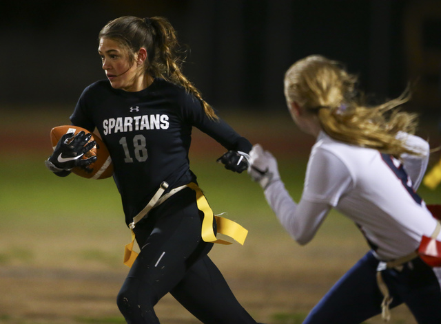 Cimarron-Memorial's Haylei Hughes (18) runs the ball against Coronado during the Class ...