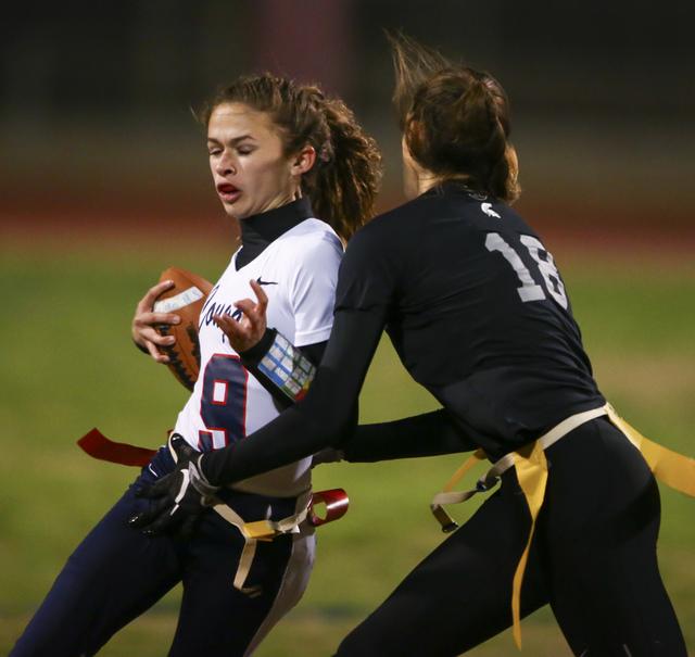 Cimarron-Memorial's Haylei Hughes (18) tags out Coronado's Caitlin Shannon (9) d ...
