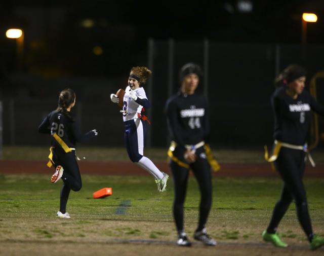Coronado's Shawna Slater (3) celebrates after scoring a touchdown on an interception d ...