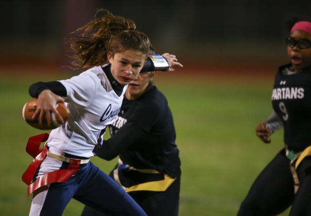 Coronado's Caitlin Shannon (9) evades Cimarron-Memorial defenders while running the ba ...