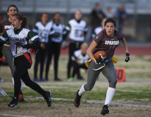 Cimarron-Memorial's Haylie Hughes (18) runs the ball against Palo Verde during the Sun ...