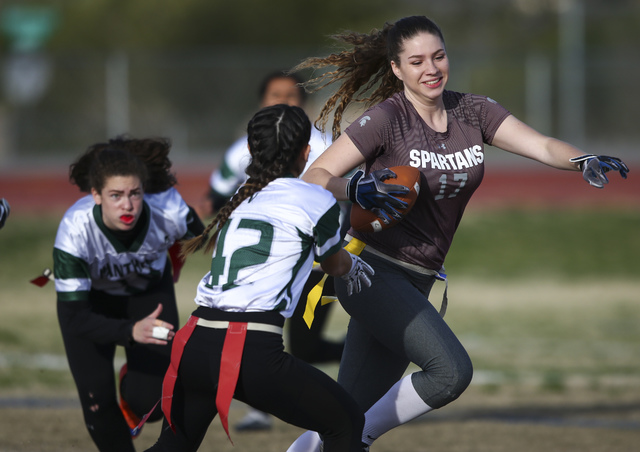 Cimarron-Memorial's Alyssa Karpinski (17) runs the ball against Palo Verde during the ...