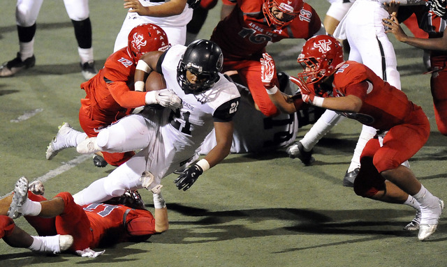 Arbor View linebacker Noah Noce (12) and defensive back Bryce Poster (15) tackle Palo Verde ...